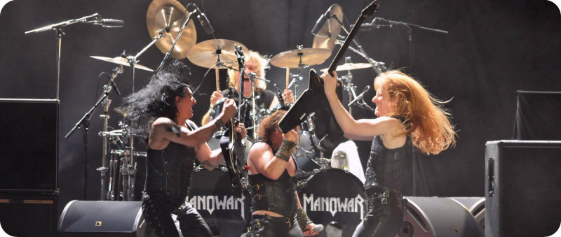 BELO HORIZONTE, BRAZIL - MAY 09:  Karl Logan (R), Eric Adams (C, front), Joey DeMaio (L) and Donnie Hamzik (C, back), of North-American band Manowar, perform during a concert at Chevrolet Hall as part of their South American tour on May 9, 2010 in Belo Horizonte, Brazil. (Photo by Alexandre Guzanshe/FotoArena/LatinContent/Getty Images)
